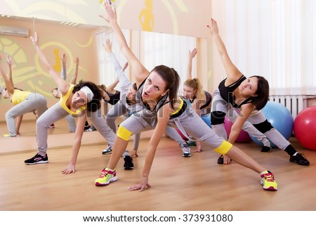 Fitness, sports, health, fitness and lifestyle concept. Beautiful Caucasian, European girls. Stretching workout indoors. - stock photo