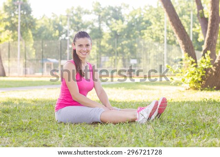 Fitness, Sporty ,Healthy Lifestyle , Smiling Female Relaxing at beautiful summer day in the park.
