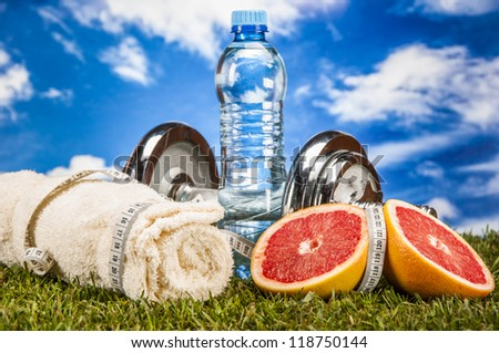 Fitness stuff with light background and fruits