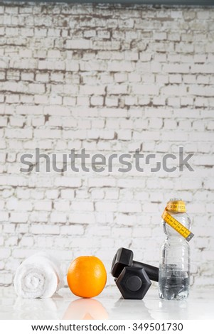 Fitness symbolic with , weight, water bottle and towels - stock photo