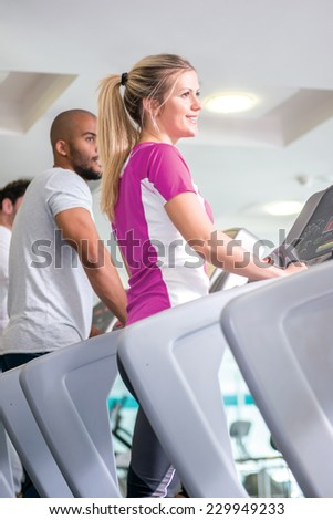 Fitness together on cross trainers. man and woman running on a CROSS TRAINERS