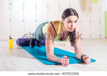 fitness training athletic sporty woman doing plank exercise in gym or yoga class concept exercising workout aerobic - stock photo