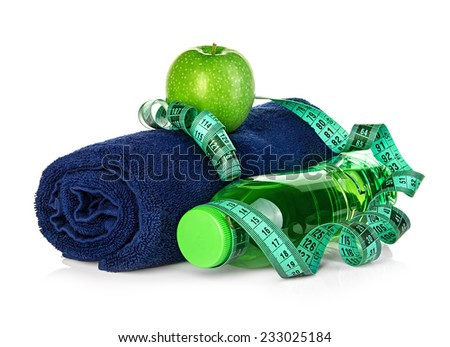 Fitness, weight loss concept with towel, green apple, bottle of drinking water and tape measure isolated on white background - stock photo