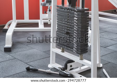 fitness weights machine in a gym room