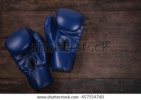 Fitness with boxing gloves. Top View from above on wooden background. - stock photo