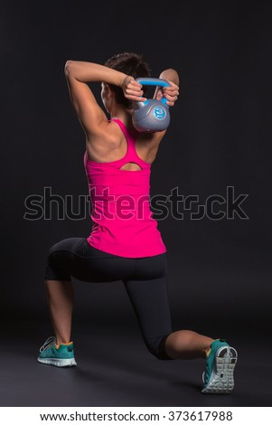 Fitness woman doing a weight training - stock photo