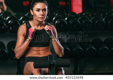 fitness woman doing abdominal crunch in gym woking out  - stock photo