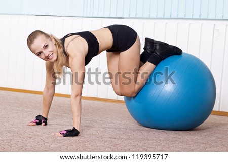 fitness woman doing exercises for muscle press with abs Swiss ball