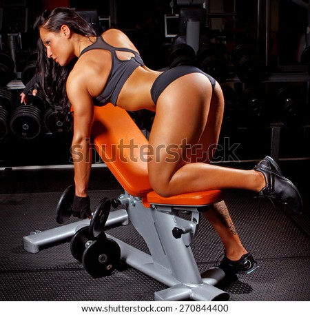 Fitness woman doing exercises in a gym