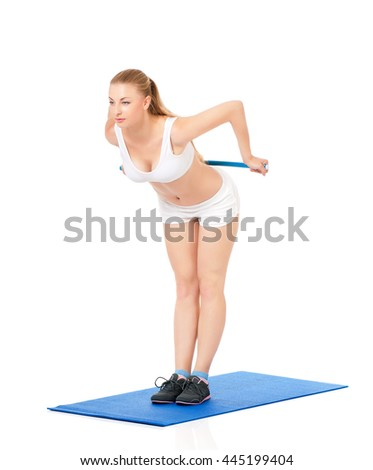 Fitness woman doing stretching exercise, full length portrait isolated over white background