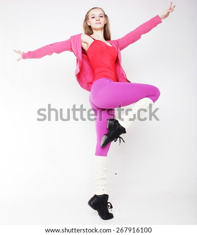 Fitness woman doing stretching exercise, over white bqackground  - stock photo