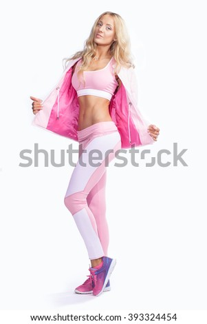 fitness woman dressed in pink sportswear isolated on white background - stock photo