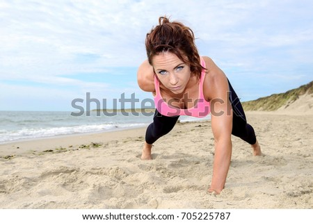fitness woman have workout on the beach