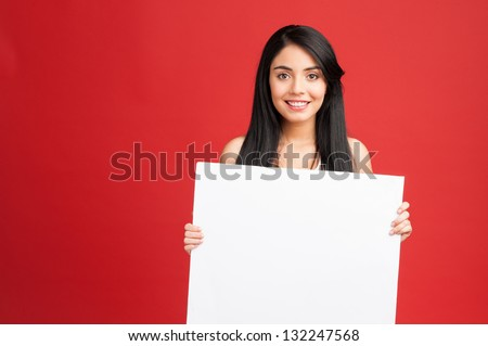 Fitness woman holding white empty banner - stock photo