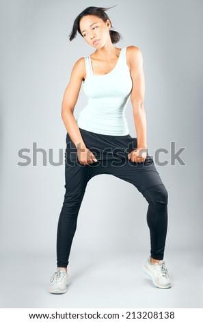 Fitness woman in sport style posing in studio. - stock photo