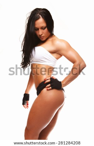 Fitness woman in sportswear with long black hair. Isolated on white background - stock photo