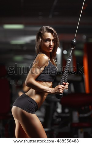 Fitness woman in the gym. Young woman doing fitness exercises in the gym. Crossfit woman