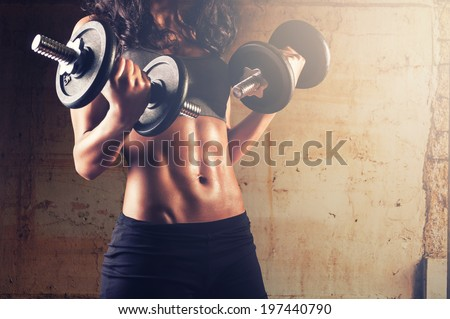 Fitness woman in training.Strong abs showing - stock photo
