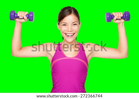 Fitness woman lifting weights smiling happy isolated cutout on green chroma key background. Fit sporty mixed race Asian Caucasian female fitness model.