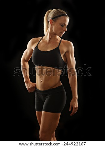 Fitness woman on a black background