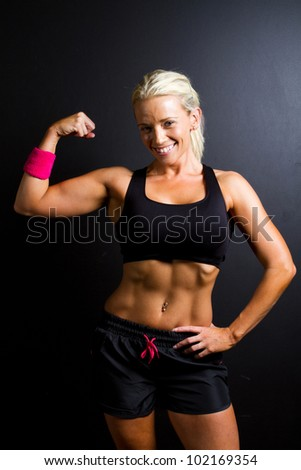 fitness woman on black background - stock photo