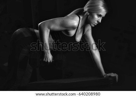 Fitness woman on black background - Stock image