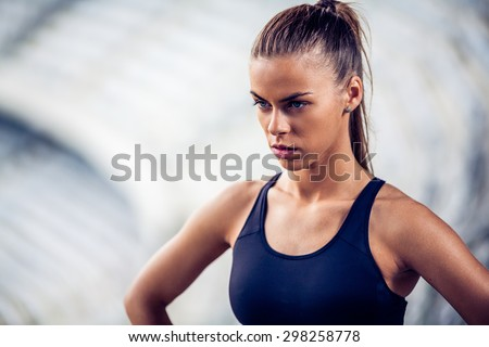 Fitness woman on stadium warming up on stairs