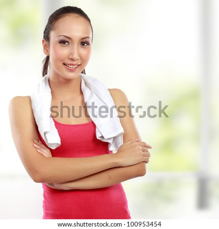 Fitness woman portrait looking at camera at the gym - stock photo