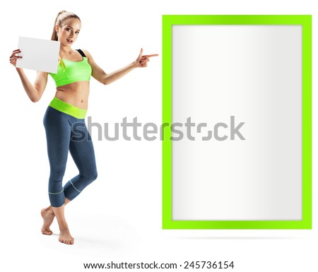 Fitness woman presenting empty placard - stock photo