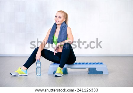 Fitness woman resting after exercises in gym  - stock photo
