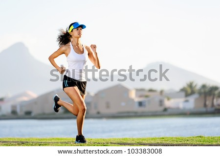 Fitness woman running in a suburb at sunset, healthy wellness workout exercise  athlete.