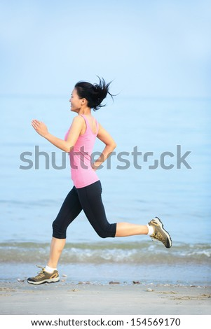 fitness woman running seaside beach - stock photo