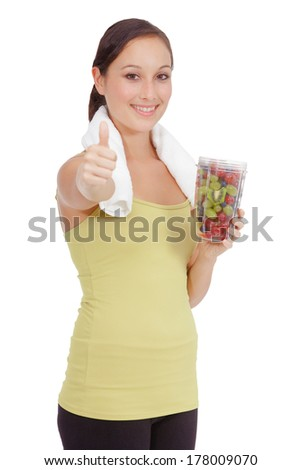 Fitness woman. Smiling happy caucasian fitness girl with water bottle and fruit. Gorgeous smiling caucasian model isolated on white background.