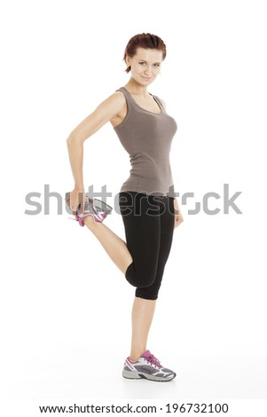 Fitness woman stretching her leg to warm up, on white background
