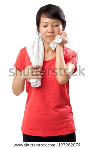 Fitness woman wiping sweat off on white background