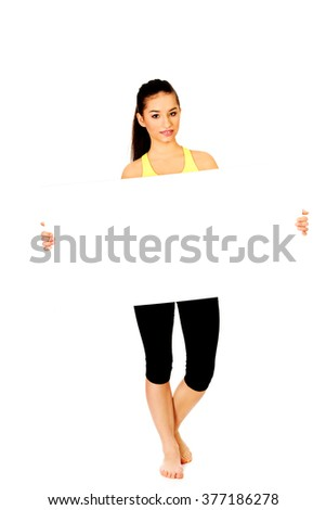 Fitness woman with empty placard. - stock photo