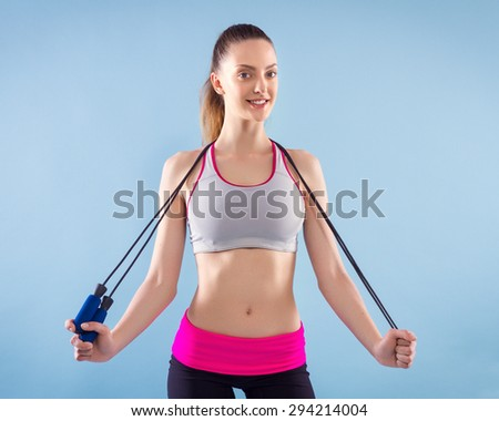 Fitness Woman With Jumping Rope - stock photo