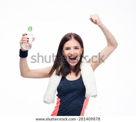 Fitness woman with towel and bottle of water celebrating her victory isolated on a white background. Looking at camera - stock photo