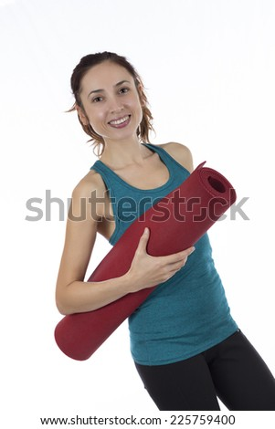 Fitness woman with yoga mat - stock photo
