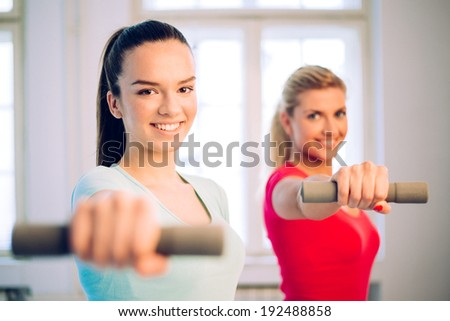 fitness women working out with dumbbells   - stock photo