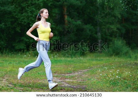Fitness, workout, sport, lifestyle concept - woman running on the nature summer - stock photo