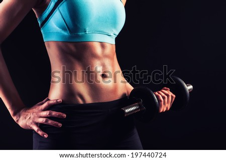 Fitness workout.Strong abs and body showoff - stock photo