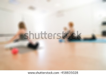 Fitness yoga class theme creative abstract blur background with bokeh effect - stock photo
