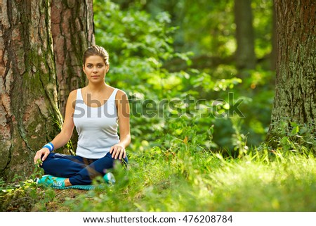 Fitness yoga exercise in wood. Young woman healthy lifestyle portrait in nature.
