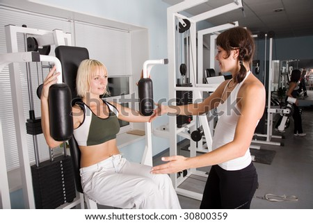 Fitness. Young caucasian women in the gym - stock photo