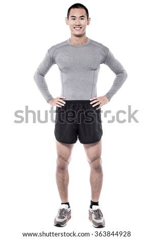 Fitness young man posing over white casually