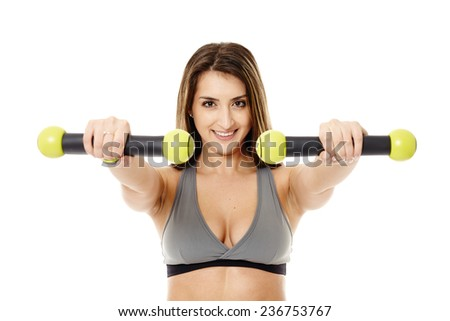 Fitness young woman doing cardio aerobic exercises with light dumbbells