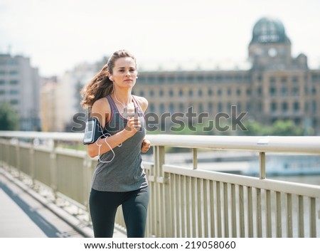 Fitness young woman jogging in the city - stock photo