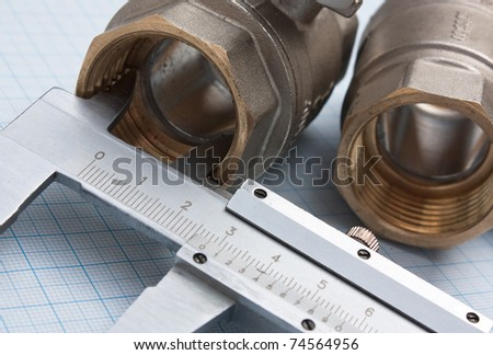 fitting and callipers  on a background of graph paper