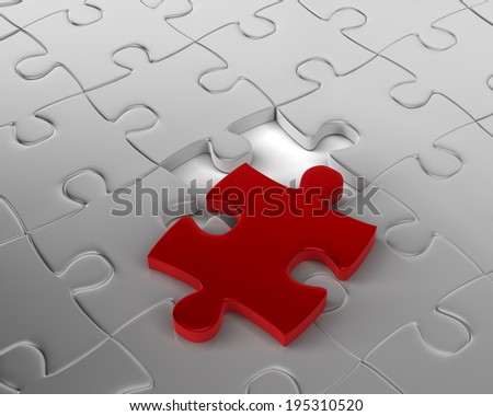 Fitting Red Jigsaw Piece Last Piece of the Puzzle - stock photo